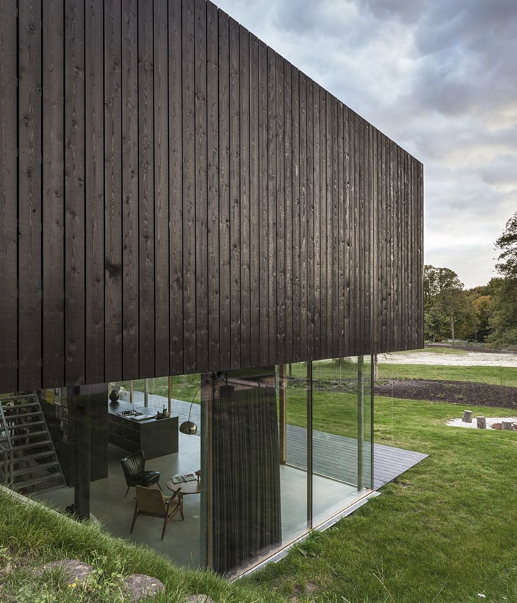 Wood and glass facade of Modern Villa V by Paul de Ruiter Architects