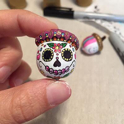 Acorn painted like a candy skull (Dia de los Muertos)