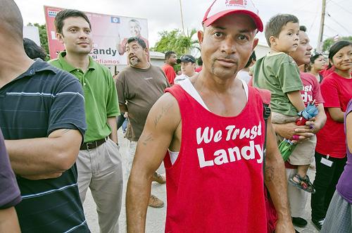 'We Trust Landy'. UDP supporter shows his color.