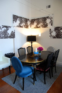 Amazing Wall Art near the Colorful Upholstered Dining Chairs and Dark Table beside Black Floor Lamp