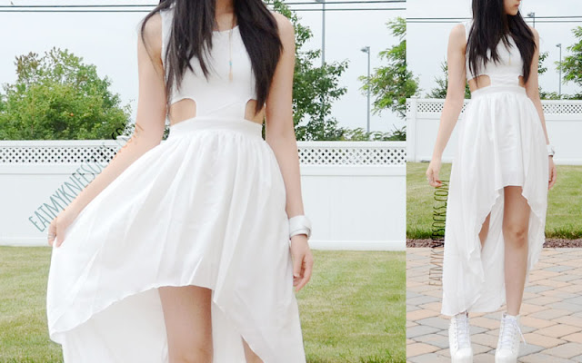 An edgy-chic all-white summer/spring street-style OOTD, with a flowy, graceful, romantic high-low cutout dress and spiked high-heel booties.