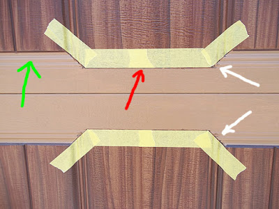 tape off garage door to paint like wood