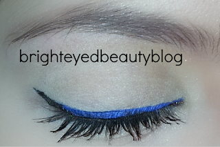 Bright blue and black ombre eyeliner look (eye closed)