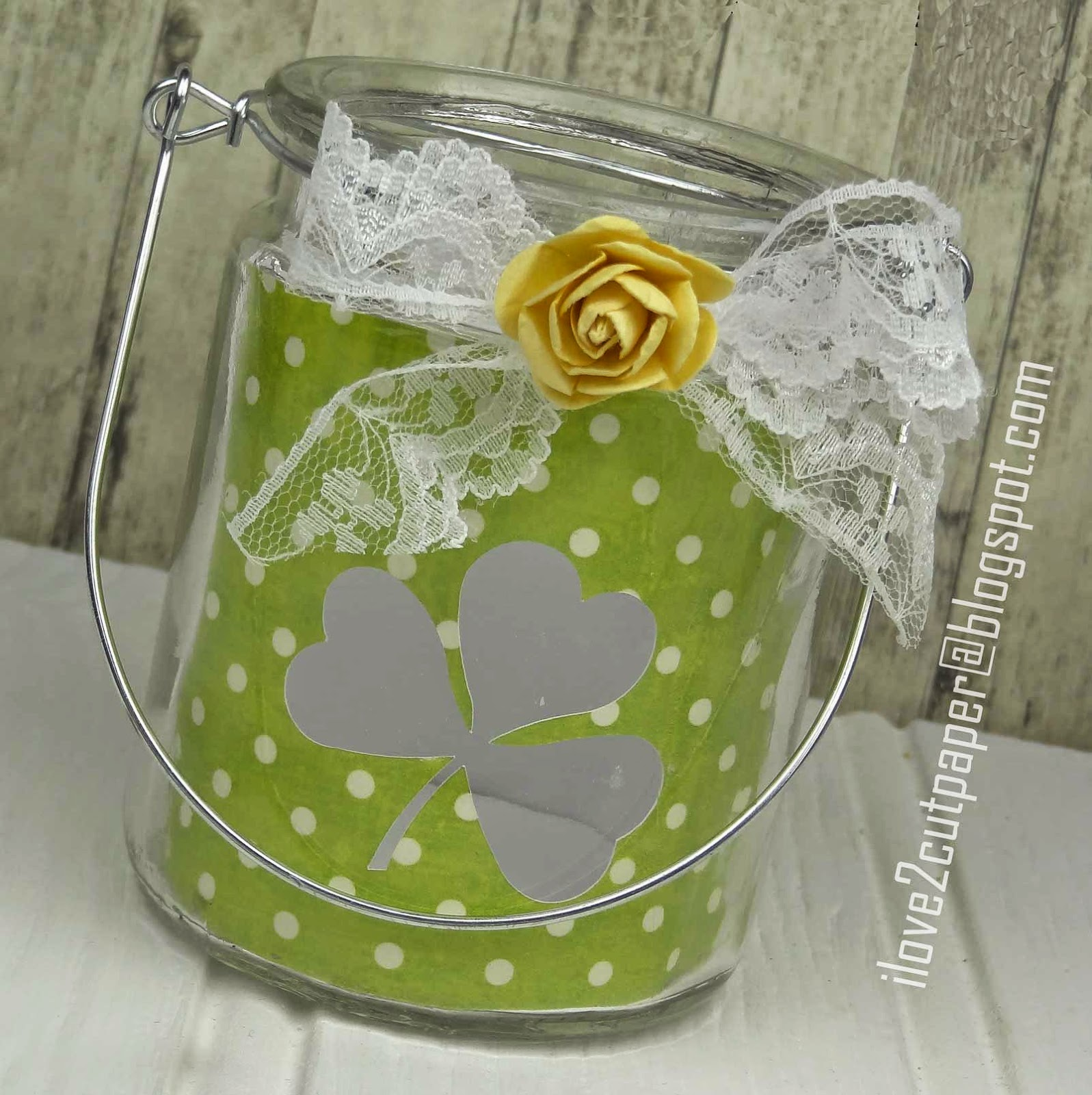 Decorated glass jar with clover