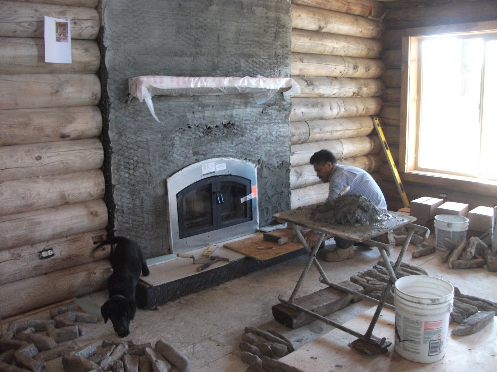 Log cabin fireplace and garage start for Log home fireplace pictures