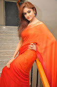 Sony Charista Glamorous in Saffron saree-thumbnail-4