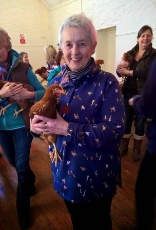 Theo Stewart holding her chicken