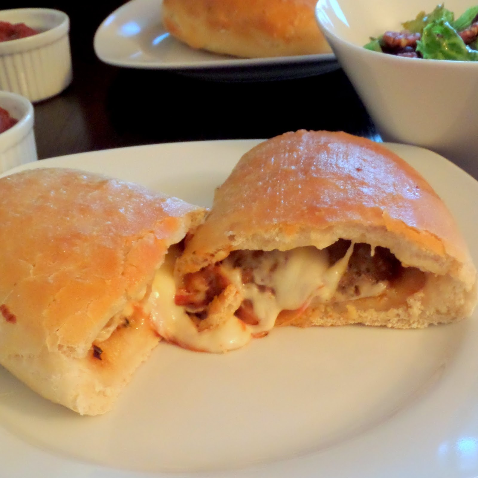 Meatball Calzones:  Hot gooey cheese and meatballs folded inside a soft and chewy pizza crust.