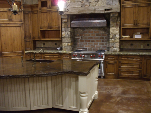 Custom Cabinetry By Tharp Cabinets, Loveland, CO. Stained Concrete Floors  By Mike Rogers, Fort Scott, KS. Granite Counters By Signature Granite,  Joplin, MO.
