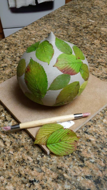 Ceramic pottery vessel with leaves imprint, in progress.