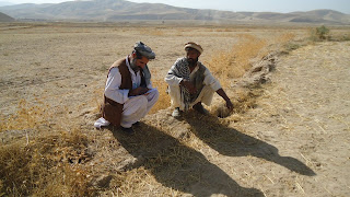 2 Afghani men sitting on roadside
