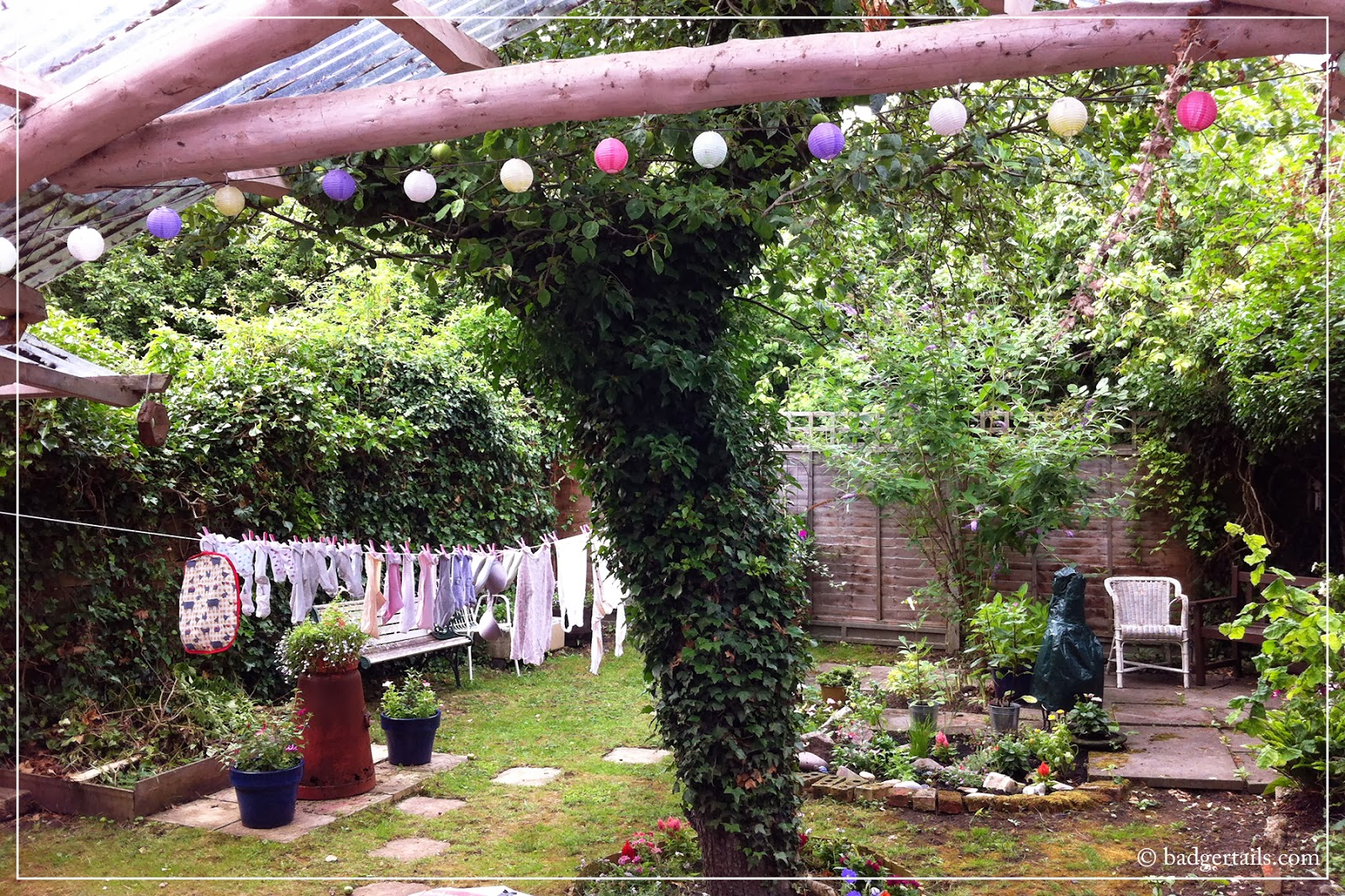 country cottage garden in summer with washing blowing on line