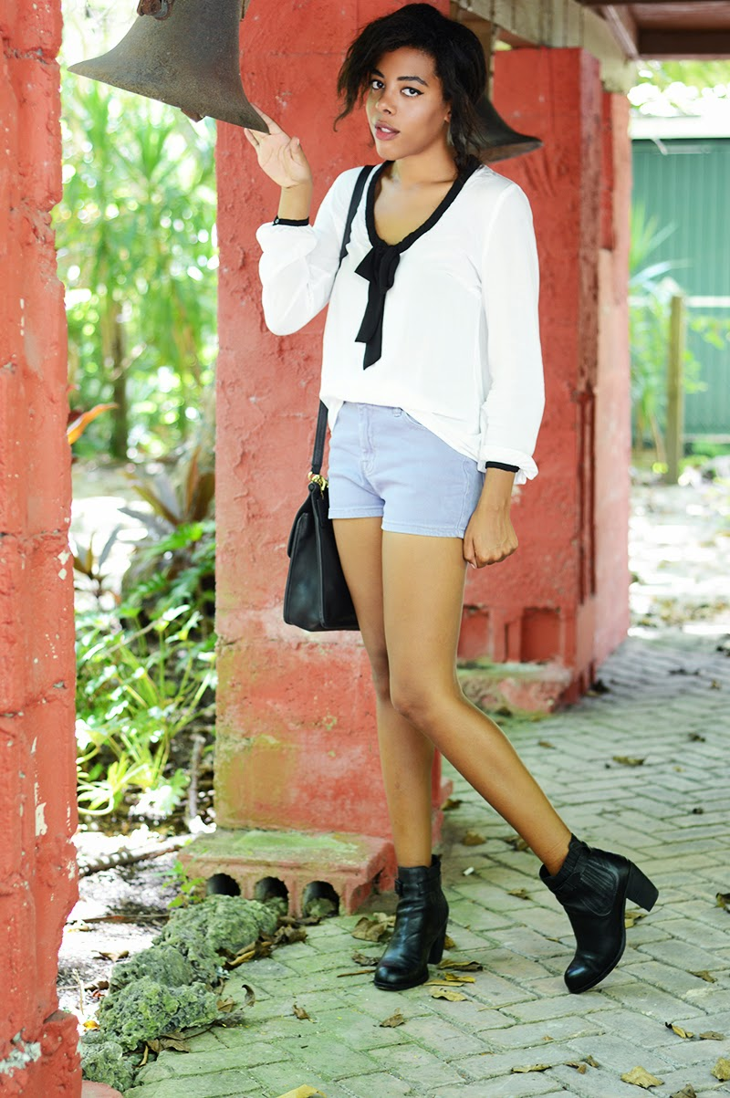 Miami Fashion Blogger Anais Alexandre of Down to Stars in a zara top with american apparel shorts and dolce vita boots with a vintage coach bag
