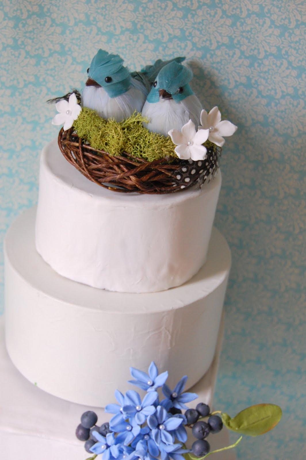 blue bird wedding cake nest for a garden wedding