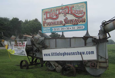 Little Log House sign on an antique harvesting machine