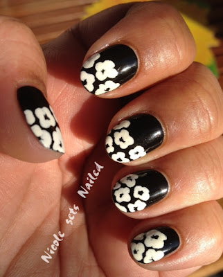 White Flowers on Black Nails Nail Art