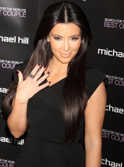kourtney kardashian engagement ring. Kim Kardashian with her