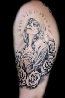 mexican death tattoo: Santa Muerte surrounded by flowers (roses)