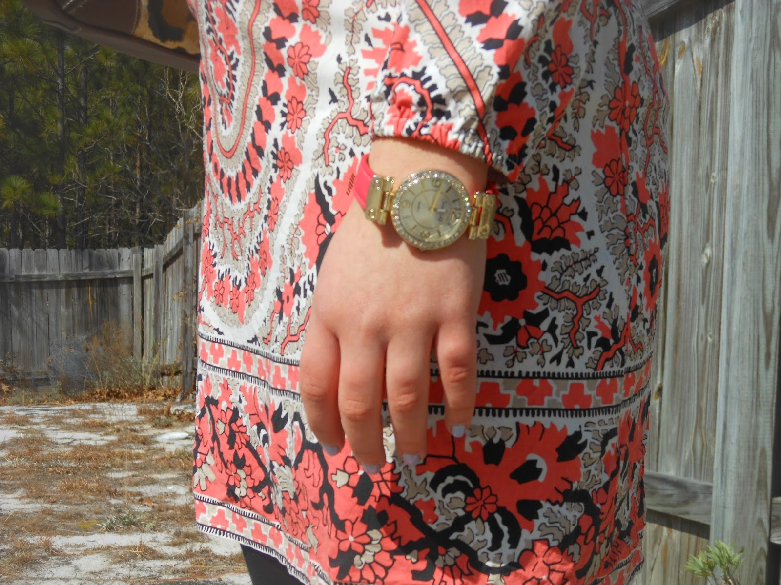 A Tunic for Tuesday. Coral patterned tunic, black leggings, brown riding boots, leopard purse.
