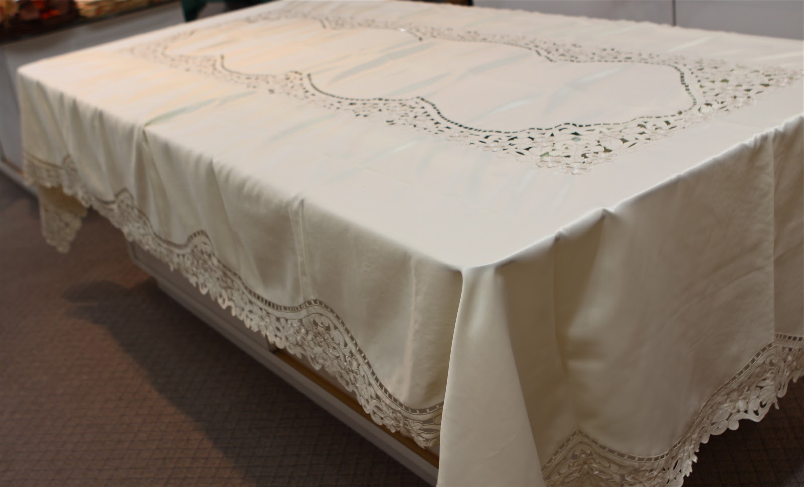They Had Lots And Lots Of White And Cream Color Cutwork Tablecloths In Many  Different Patterns.