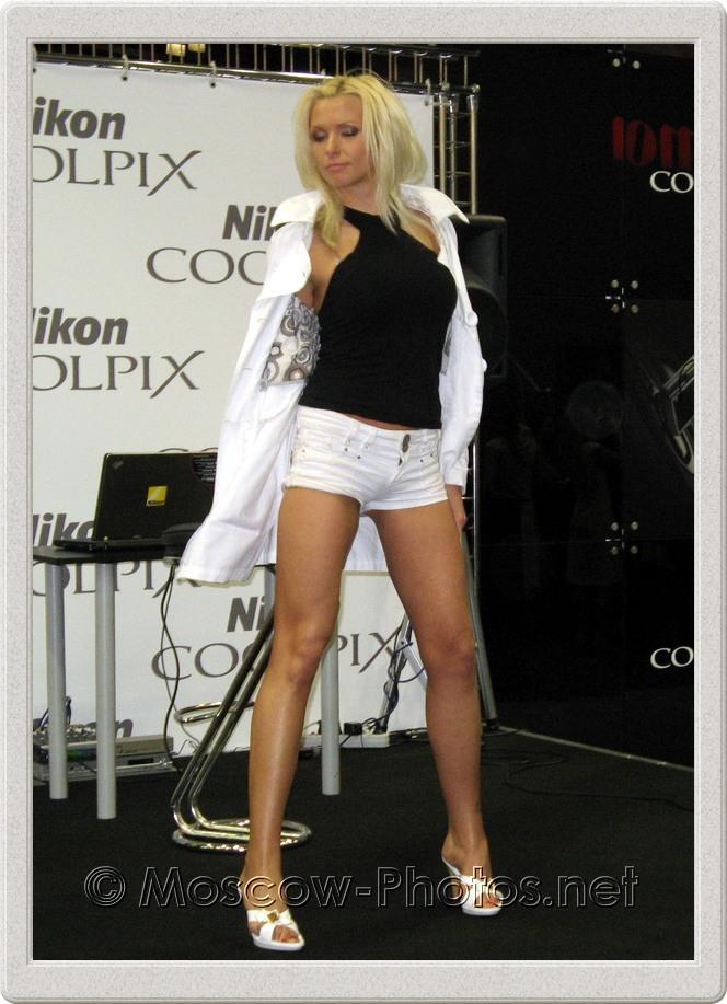 Model in white shorts posing at Photoforum - 2008