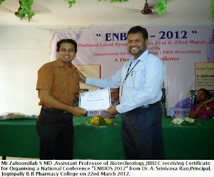 Mr Zahoorullah S MD receiving a Certificate for organising a National Conference