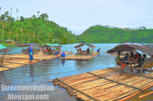 a bamboo raft is leaving from the bank of Lake Pandin