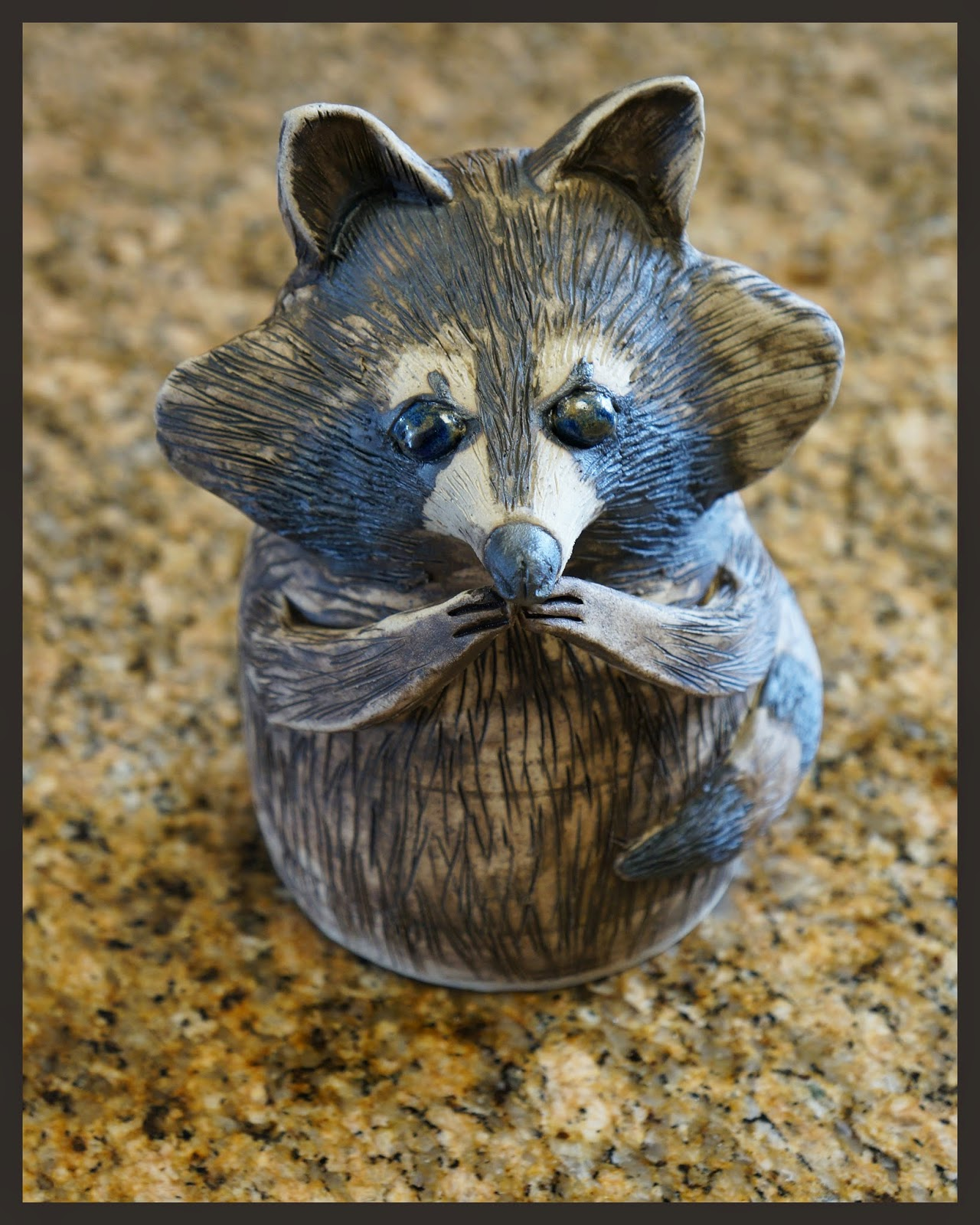 Beautiful handmade ceramic stoneware raccoon for the garden.