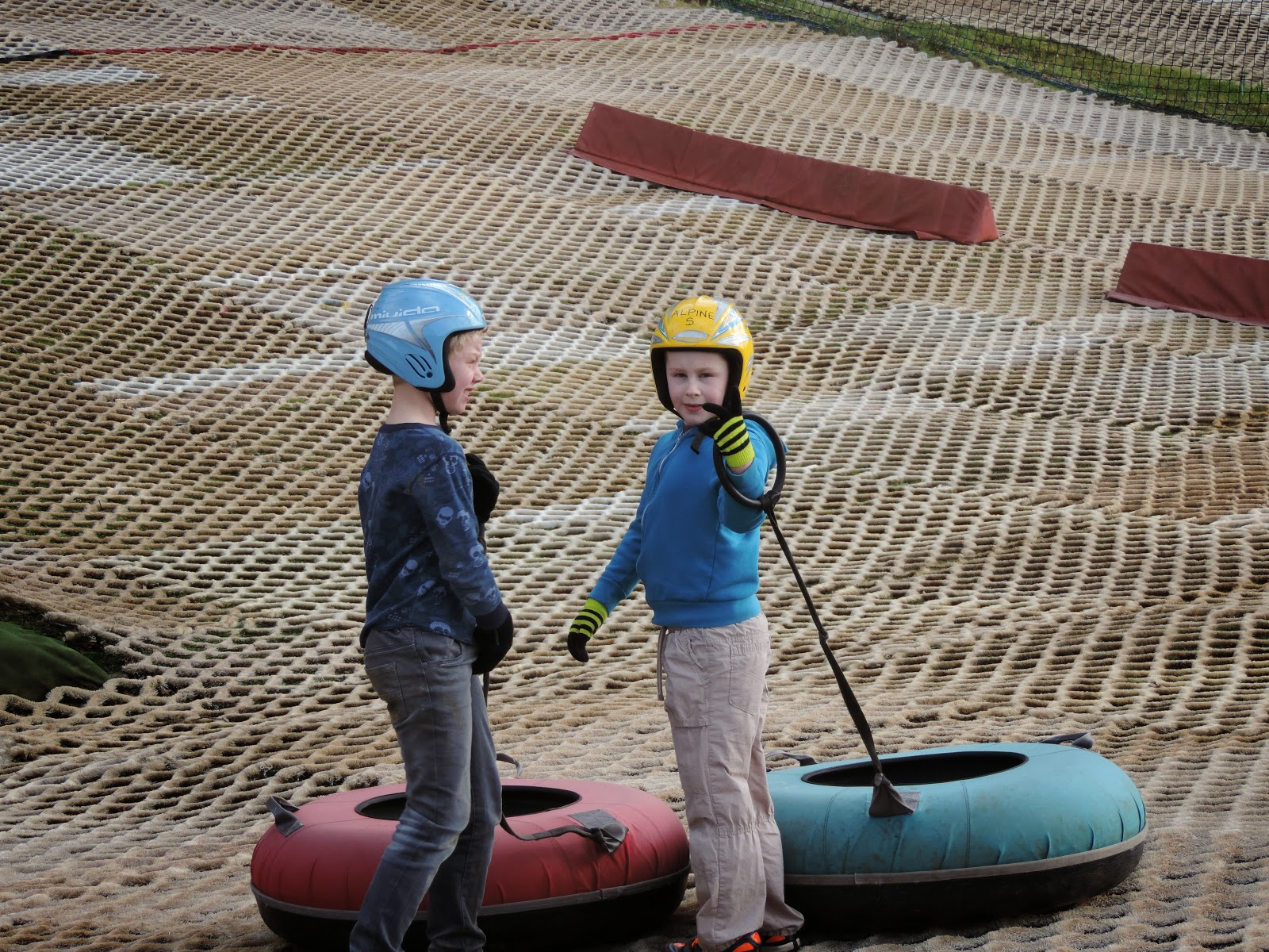 dry ski slope with inflatable inner tubes