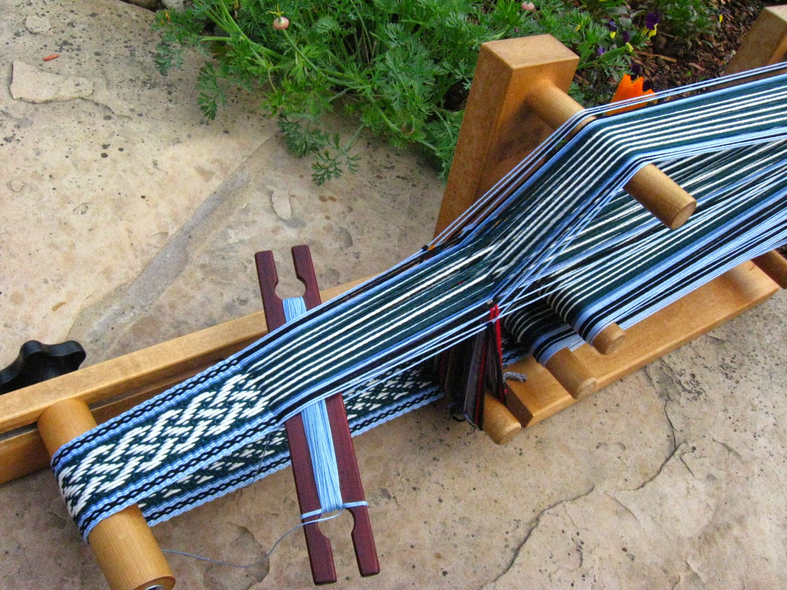 This loom is perfectly configured for ease of weaving in my opinion i much prefer the slide type tensioner of this loom to the paddle type