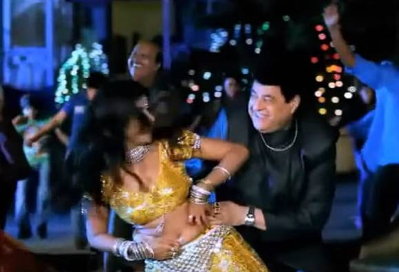 """An item song featuring FTII chairman Gajendra Chauhan from an unreleased movie, Any Time Money, has been posted on YouTube.   The item song """"Chappan Churi Matwali"""" shows Gajendra Chauhan matching steps  with scantily clad Sheetal Shah.   The film, which promises an exciting fare of sex, corruption and politics, seems to have Gajendra Chauhan in a key role of a politician."""