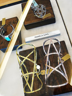 Pamela Love Snake and Pentagram cuffs.