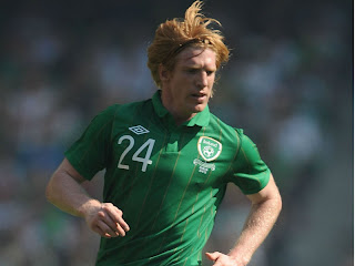 Republic of Ireland defender Paul McShane, giving it socks for his country