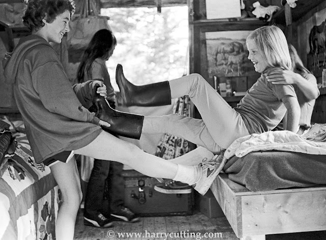 Young girls playing in dorm at horseback riding camp in Vermont.