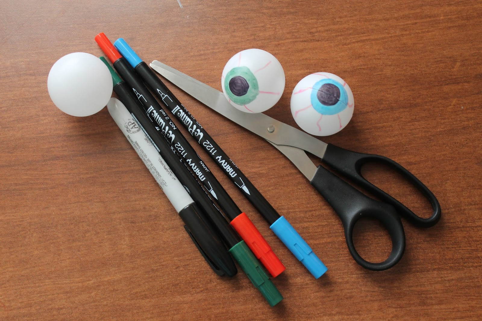 you will need ping pong balls check the dollar store for cheap ones markers and scissors - Halloween Ping Pong Balls