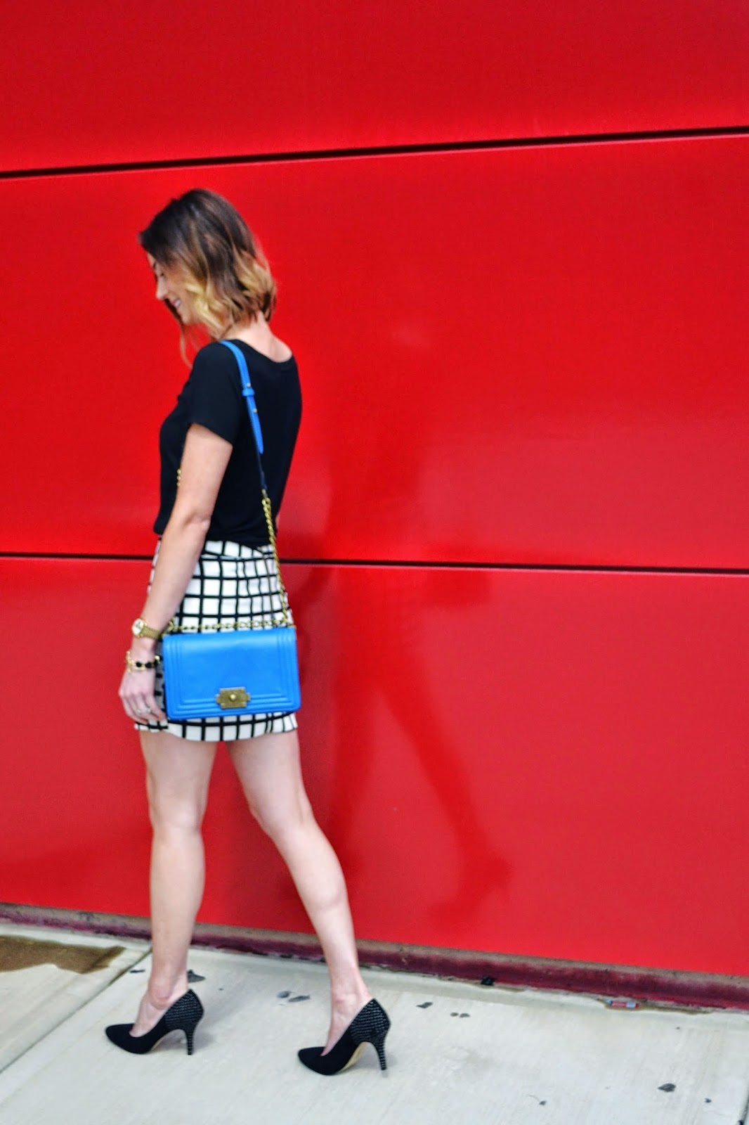 blue purse, windowpane, black and white, accessories, black pumps. wrap skirt, asymmetrical hem