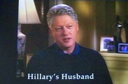 "Photo of Bill Clinton captioned ""Hillary's Husband"""
