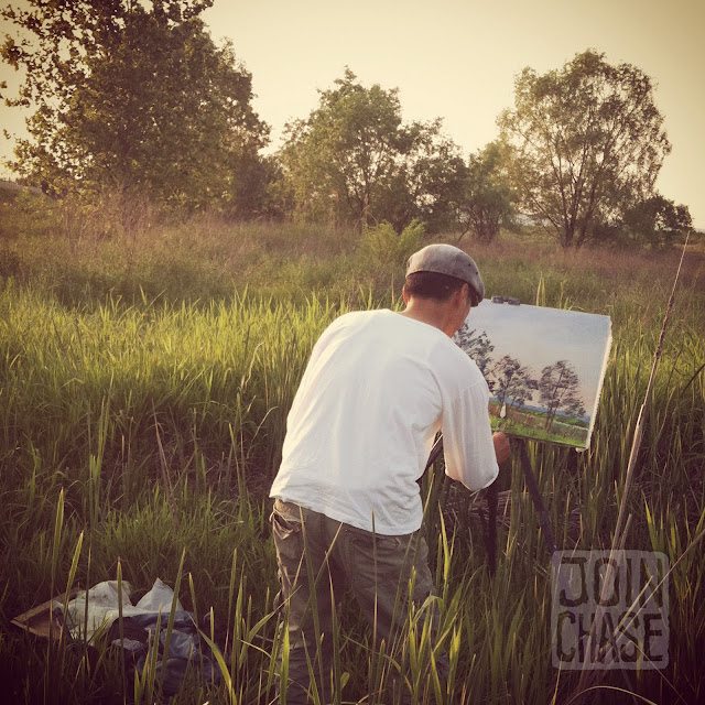 An artist painting a picture by the bike path near Cheongju, South Korea.