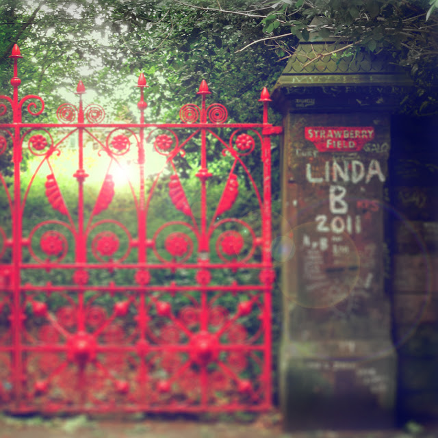 Gates and grafitti at Strawberry Field, Liverpool - Photograph by Tim Irving