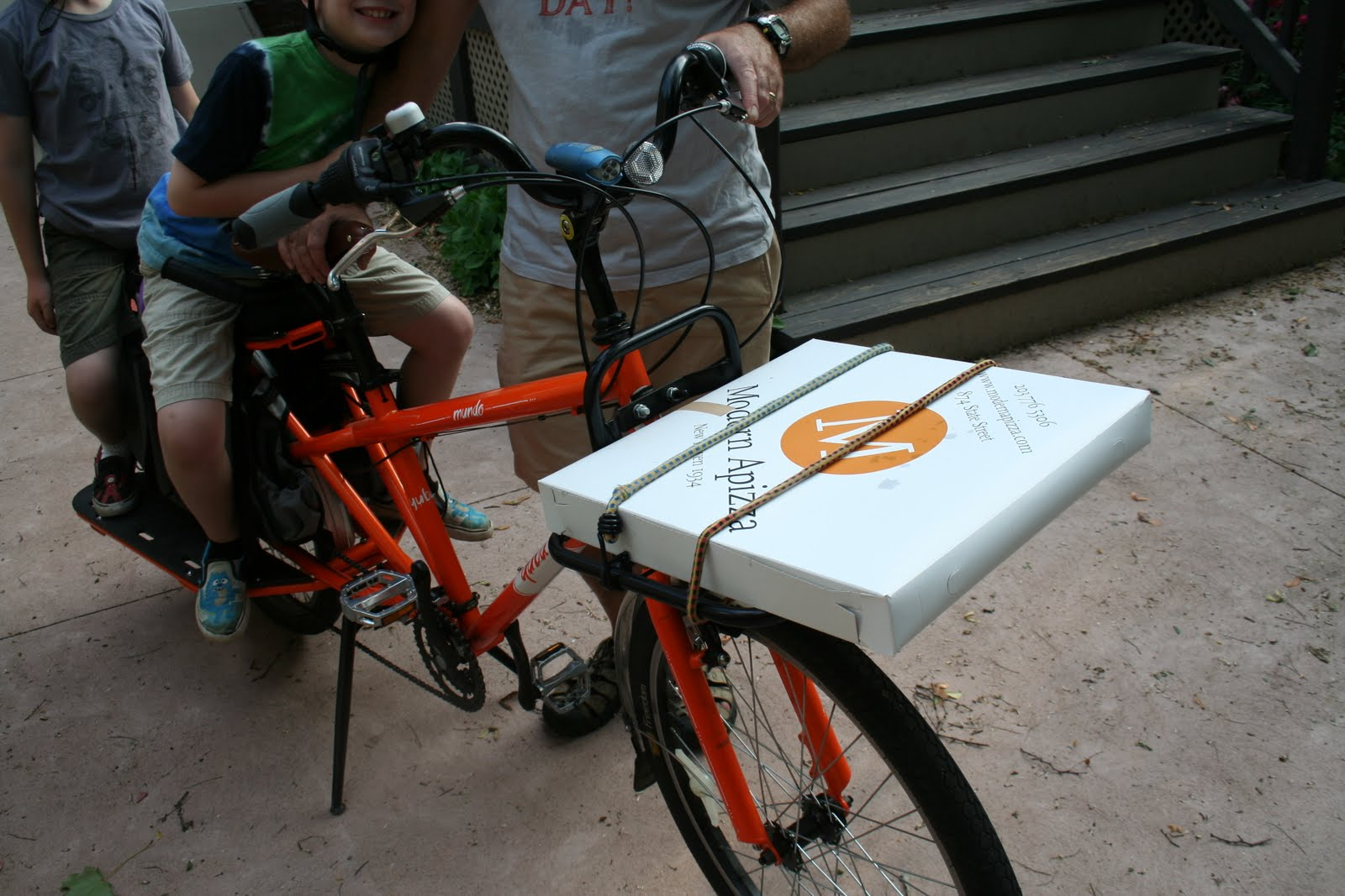 full hands: pizza delivery bike