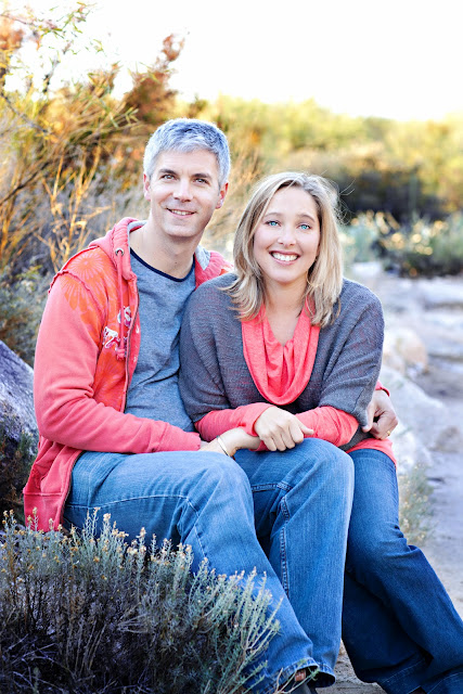 Husband and wife look naturally posed during family hike