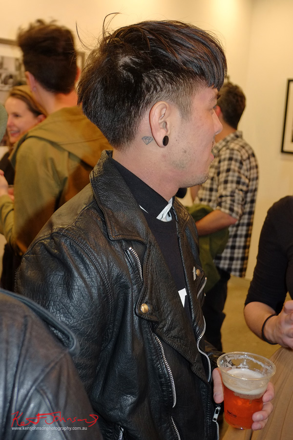 Leather jacket, diamond tattoo behind ear. Street Fashion Sydney photographed by Kent Johnson.