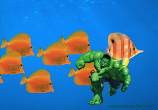 Desktop Wallpaper of The Incredible Hulk Trying to Grab You in Fishes Aquarium wallpaper