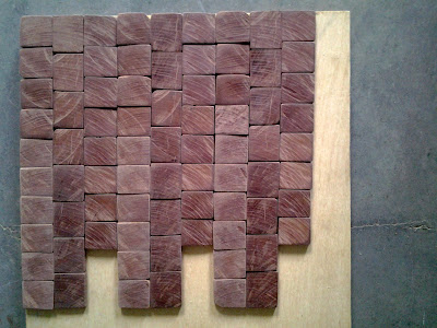 small end-grain tiles cross cut from an aged hardwood timber, possibly Black Walnut
