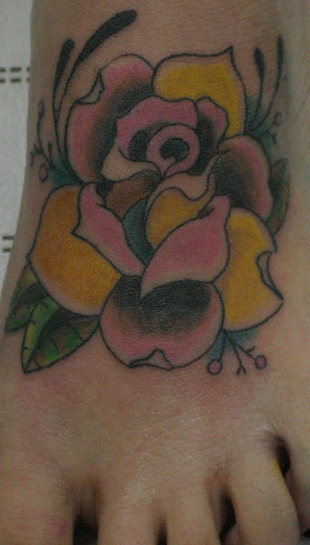 Yellow and pink wide rose foot tattoo