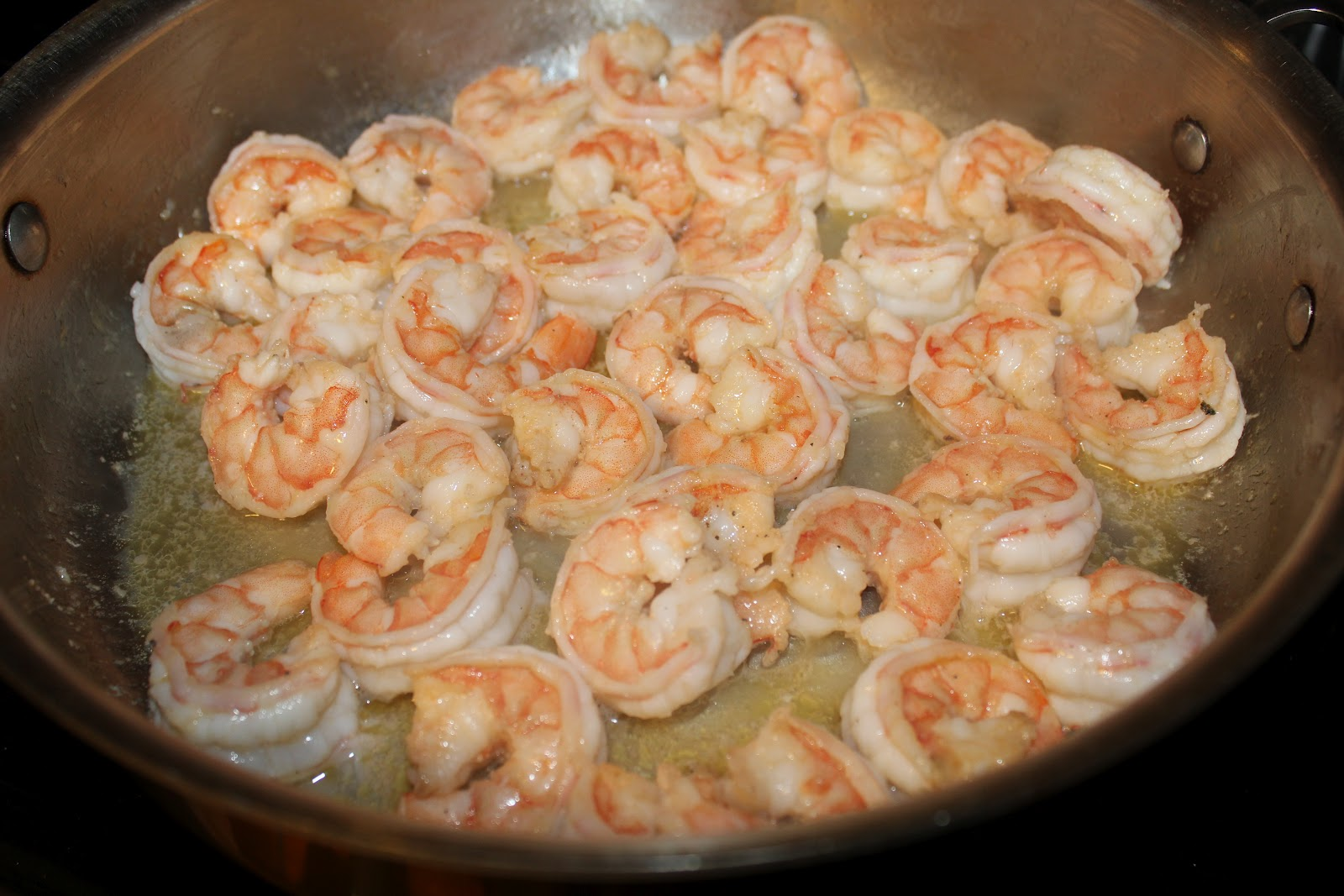 Opaque color shrimp once shrimp are cooked - In The Same Skillet Add More Butter And Olive Oil I Still Had Some Shrimp Juice In The Skillet So I Boiled It Down A Bit Before Adding The Butter And