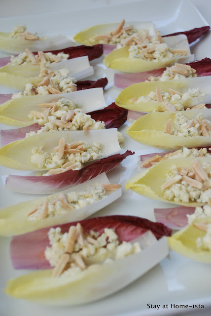 Easy Appetizer, perfect for guests! Endive layered with cheese, nuts and honey.