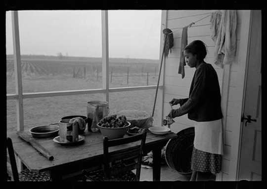 Farmer's wife grinding meat to make sausage, Lakeview Project, Arkansas, November 1938