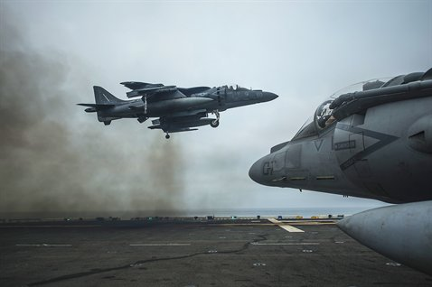 An AV-8B harrier jet performs a vertical landing on the flight deck of the USS Boxer in the Pacific Ocean, June 14, 2013. The Boxer is conducting amphibious squadron and marine expeditionary unit integrated training. The jet is part of the air combat element of the 13th Marine Expeditionary Unit. U.S. Navy photo by Petty Officer 3rd Class Mark El-Rayes