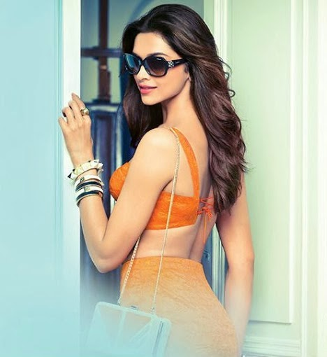 Deepika Padukone backless in orange dress inVogue Eyewear
